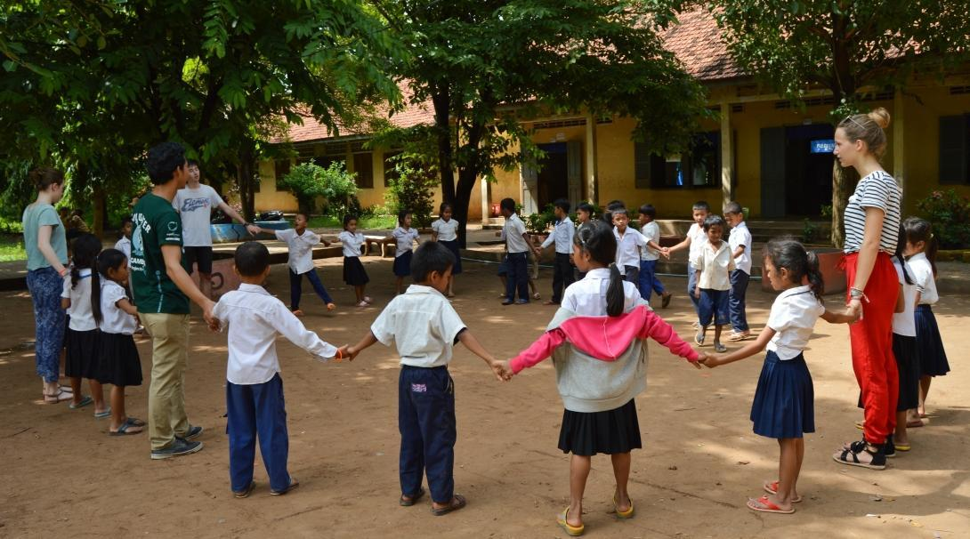 Childcare work in Cambodia for volunteers on group trips includes playing games with children, or doing fun activities.